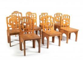 Suite de 8 chaises sculpturales