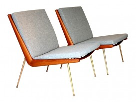 A pair of Boomerang armchairs