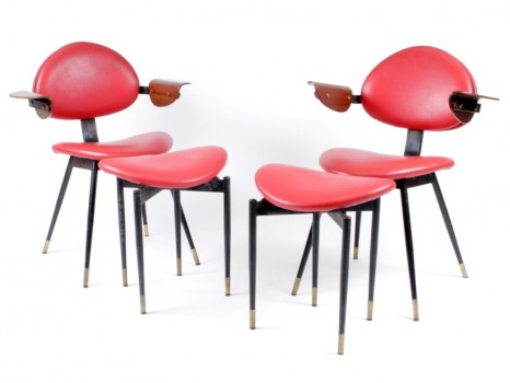 A pair of Lutrario chairs and ottoman