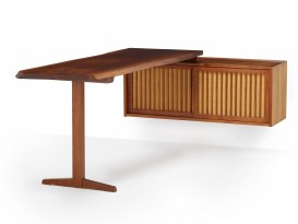 Trestle desk and its wall hanging cabinet