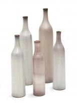 Five pale grey ceramic bottles
