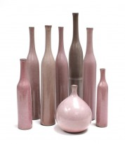 9 pink ceramic vases and bottles