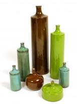 8 ceramic vases and bottles